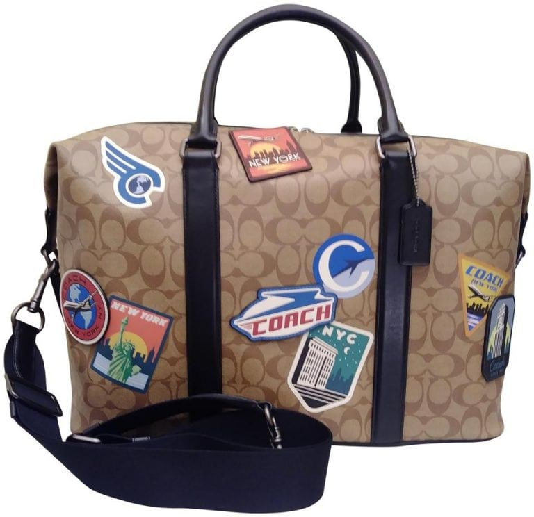 coach voyager with assorted patches brown coated canvas weekendtravel bag 0 1 960 960 768x744 1 - طرق لجعل حقيبتك تبدو جديدة تماما دون استبدالها